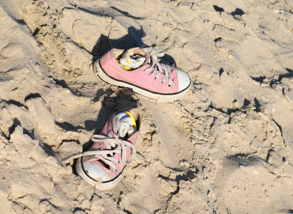 Empty sneakers on the beach