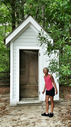 My niece Caila checking out the outhouse.