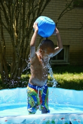 Pouring water on himself!