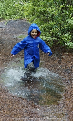 Arai having fun in a puddle in the rain.